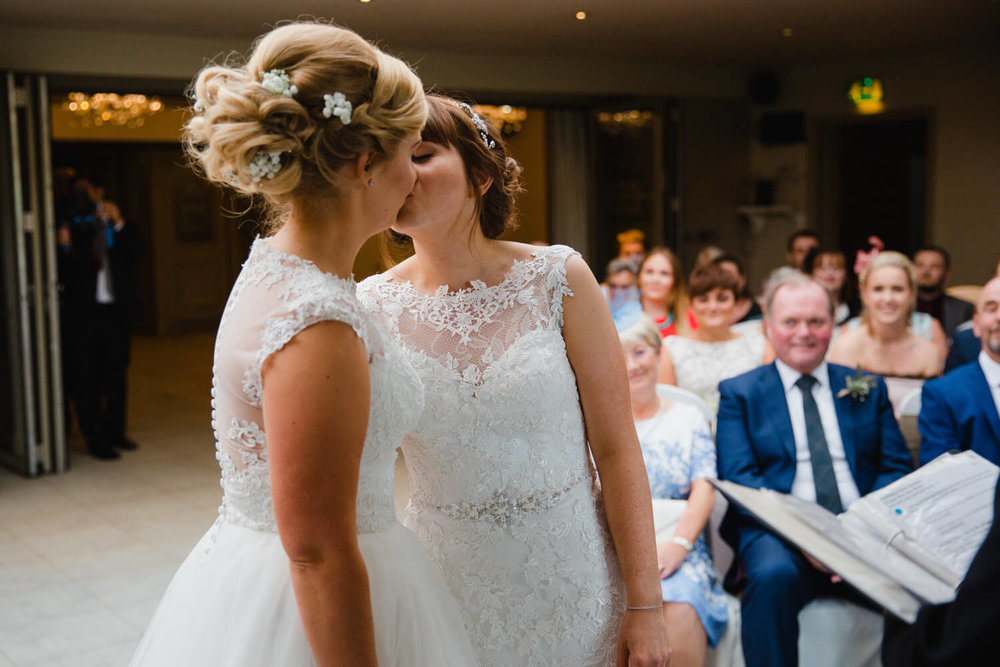 close up photograph of newlyweds first kiss at peak edge hotel