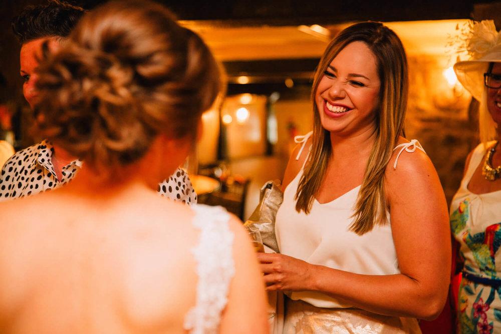 wedding guest congratulates newly wedded couple at peak edge hotel