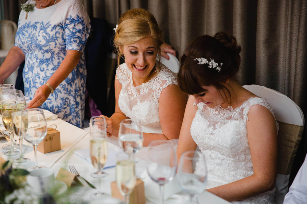 close up of brides laughing together