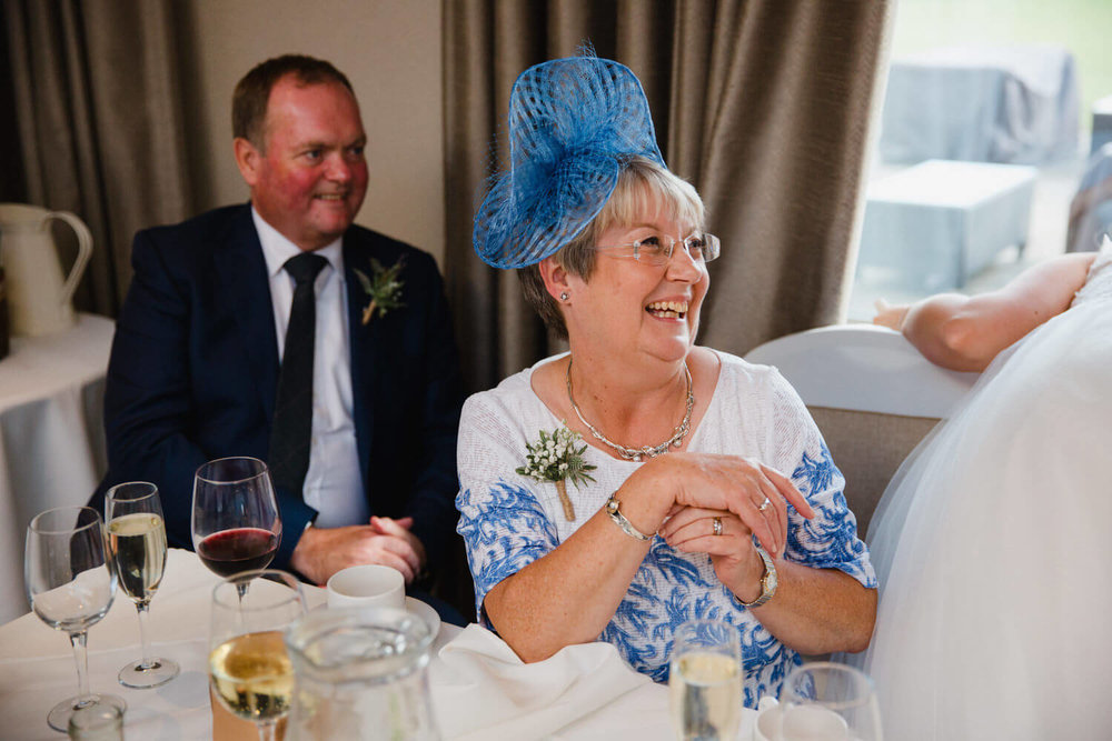 mother of bride laughing at groom speech