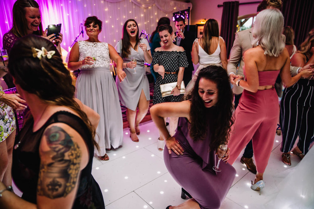bridal party dancing and laughing