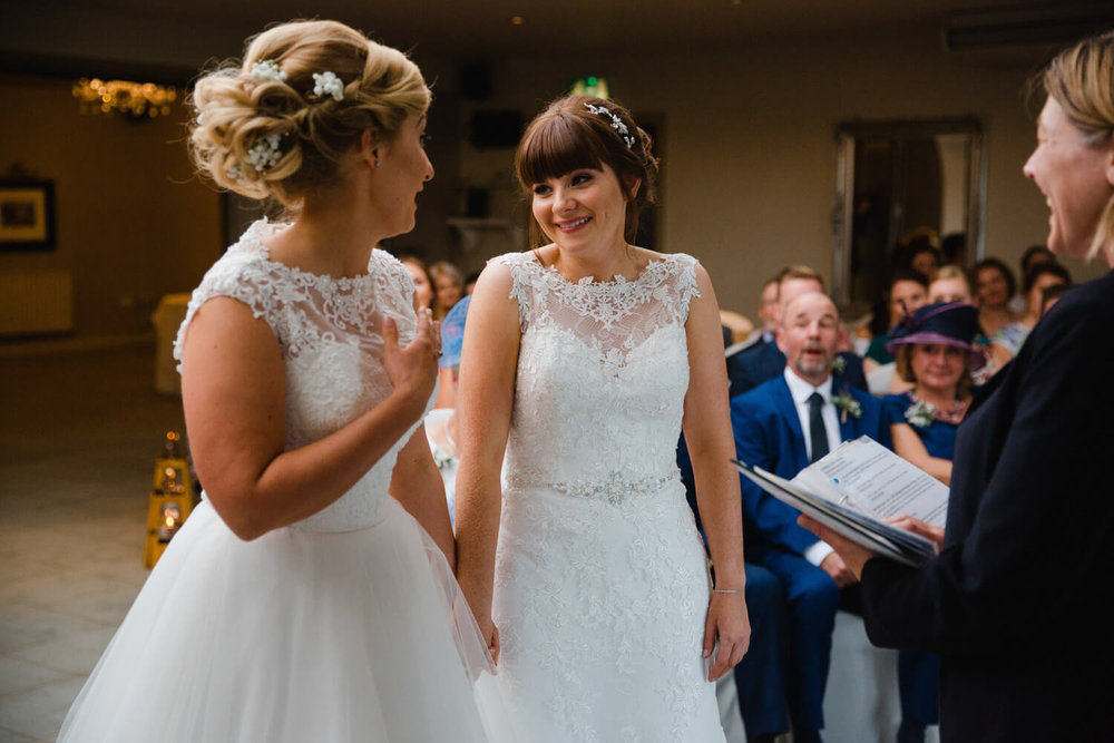 Emma and Emily deliver their wedding vows with smiles at Peak Edge Hotel