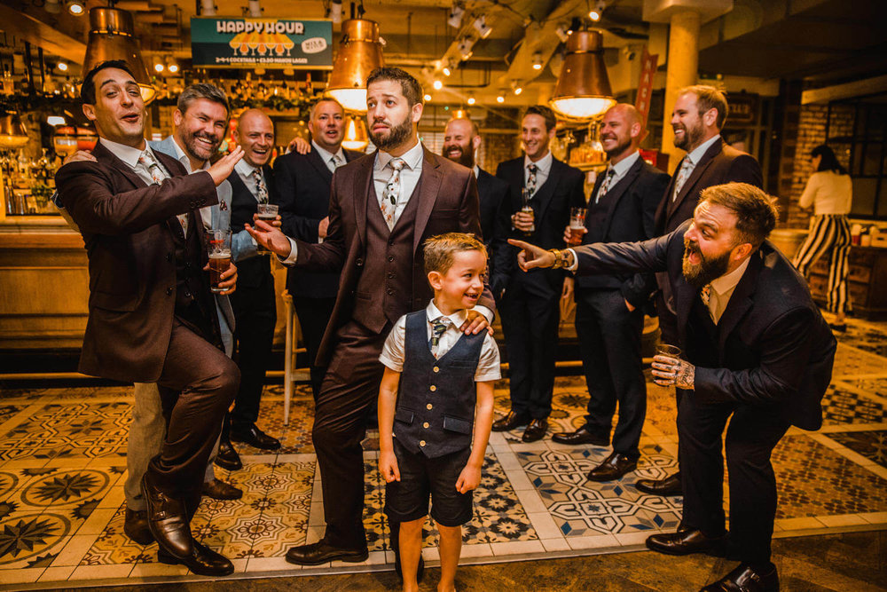 all groomsmen laughing and posing to camera together