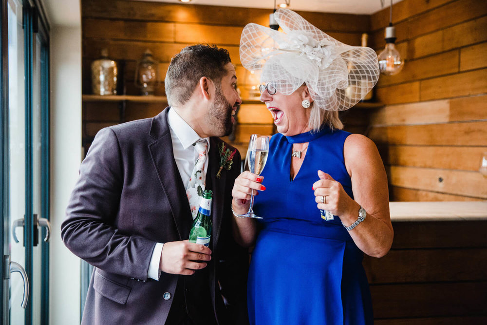 groom shares joke with aunty at the bar
