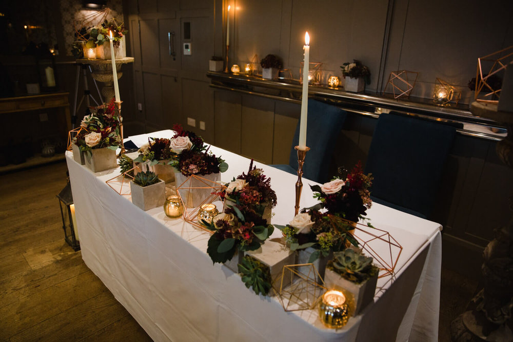 wedding ceremony table lit and set up at great john street hotel