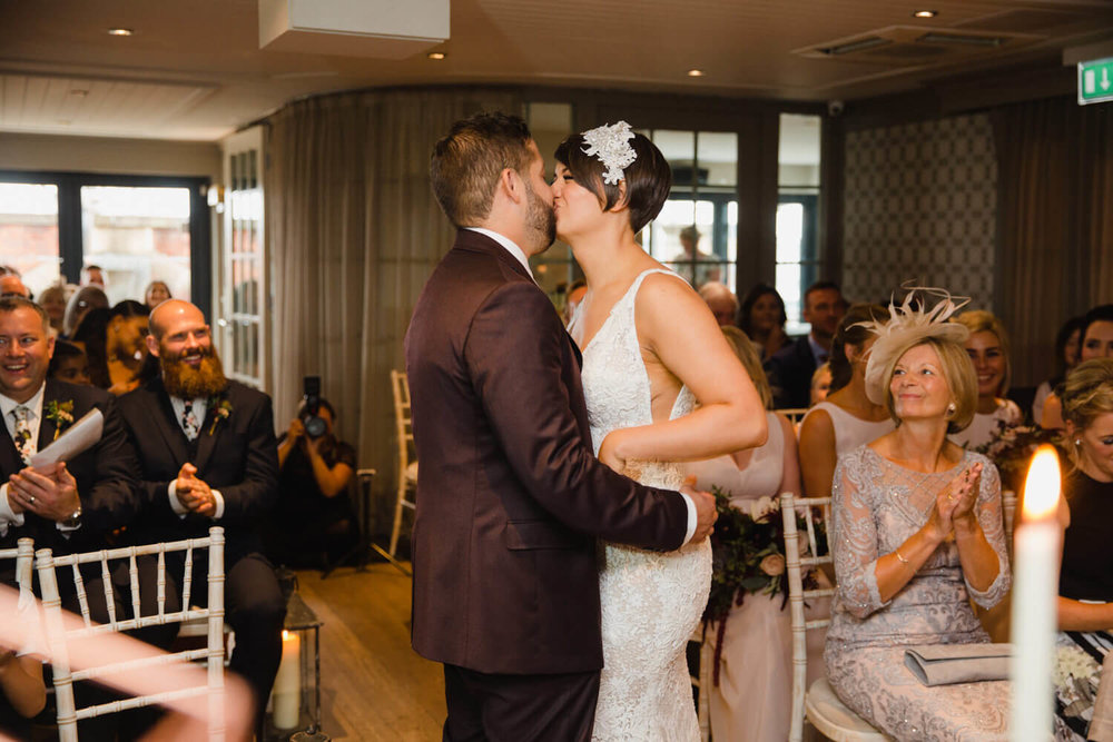 newlyweds first kiss in front of friends and family