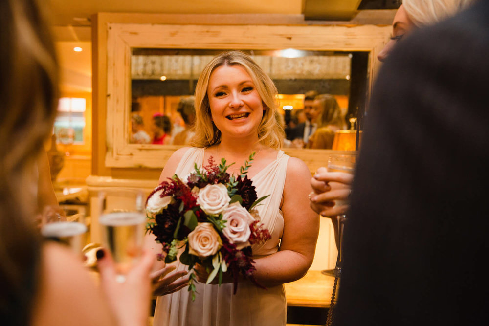 bridesmaid laughing with guests