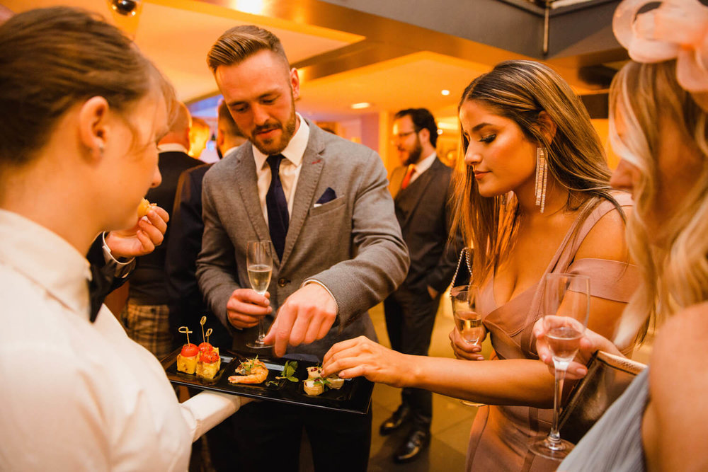 guests picking wedding canapés
