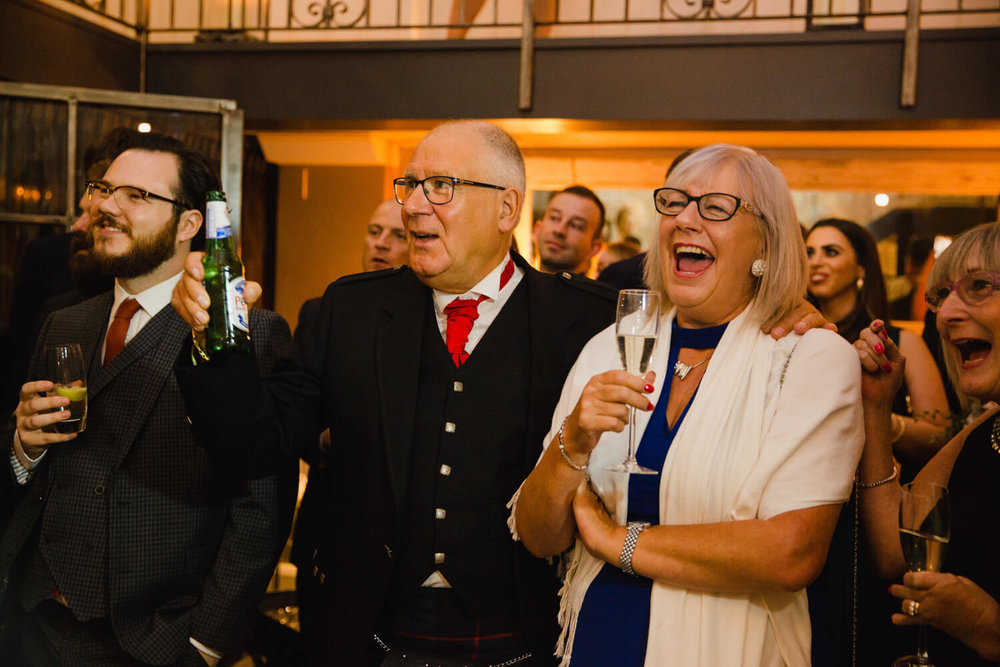 guests laughing together at wedding speeches