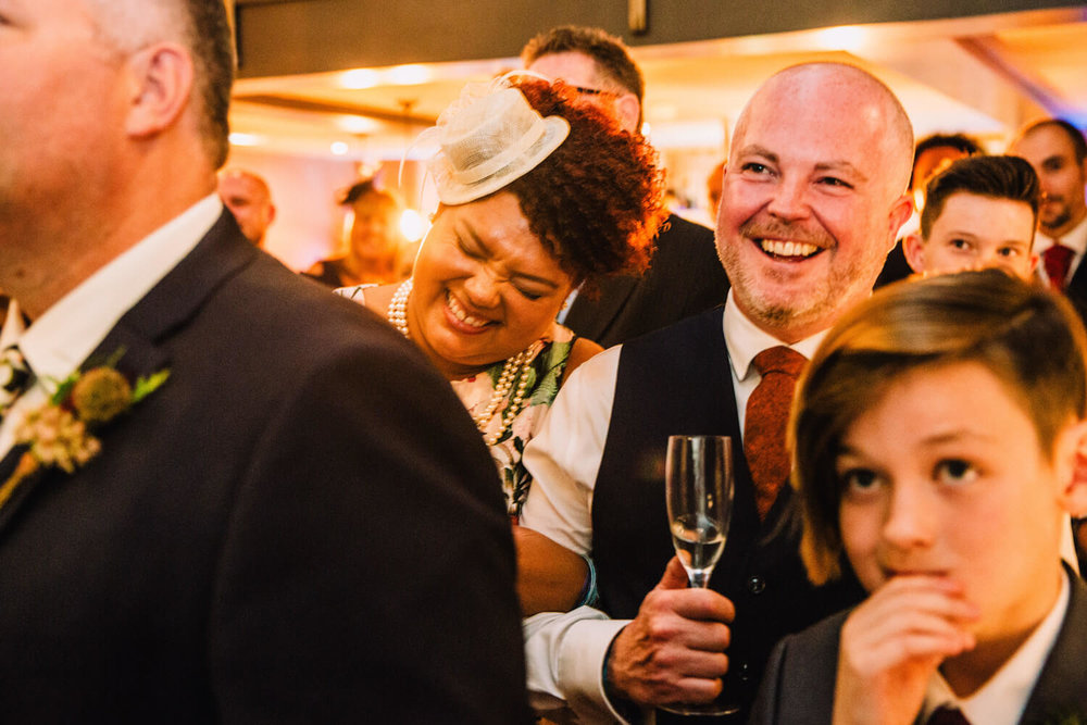 wedding guests in fits of laughter at speeches