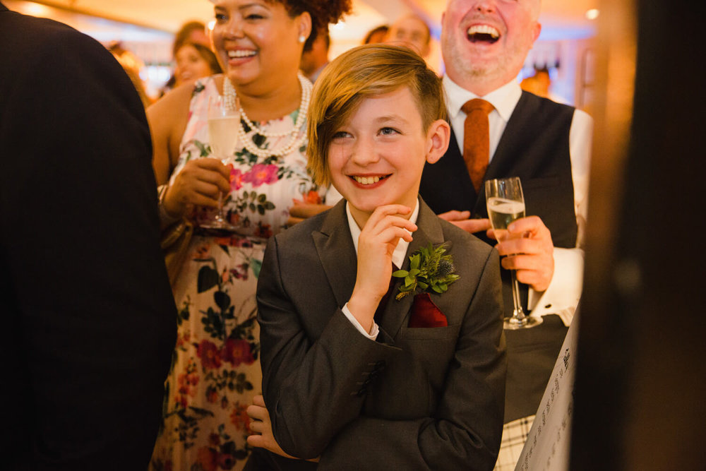 page boy laughs at groom