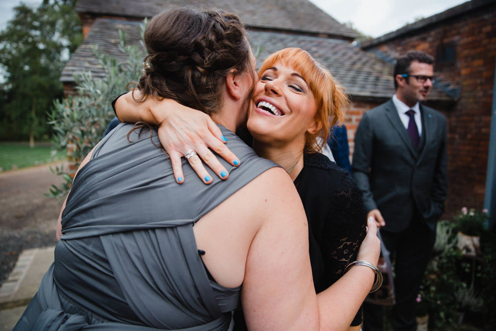 wedding guests congratulate bridesmaid