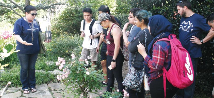 Geology and environmental science professor Tara Urbanski, left, leads students on a geology walking tour.