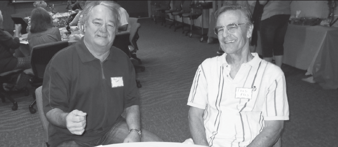 Bill Swan, left, and Fred Fels enjoy a friendly conversation before the Emeritus kickoff.