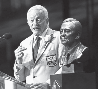 Dallas Cowboys owner Jerry Jones speaks next to his bust at the Pro Football Hall of Fame.