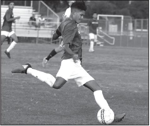 Team captain Mateo Gutierrez strikes the ball.