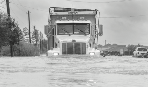 A truck tries to make it through the flooding in Houston.