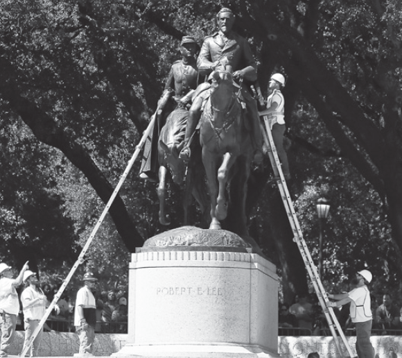 Workers prepare a statue of Robert E. Lee in Dallas' Lee Park for removal.