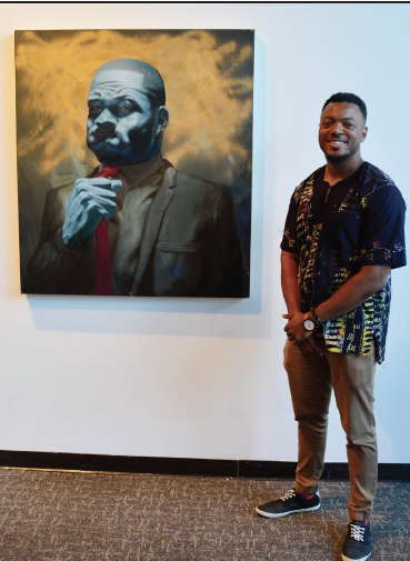Spencer Evans and one of his paintings.