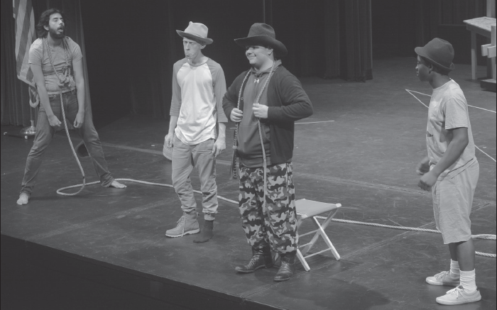 "Carlos Hernandez (Lucky), left, Carter Brown (Estragon), Shae Hardwick (Pozzo), and Jabin Lewis (Vladimir) during rehearsal of Beckett's ""Waiting for Godot."""