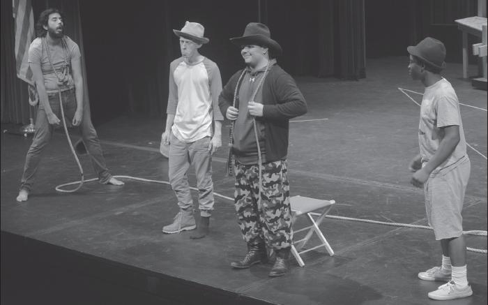 "Carlos Hernandez (Lucky), left, Carter Brown (Estragon), Shae Hardwick (Pozzo), and Jabin Lewis (Vladimir) during rehearsal of Beckett's ""Waiting for Godot."""