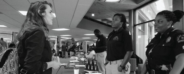 Richland senior Anna Tanner, left,  talks with representatives from the Dallas Police Department at last year's job fair.