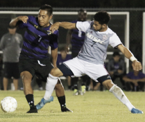 Erwin Regules, left, shields the ball away from a Mount San Antonio defender.