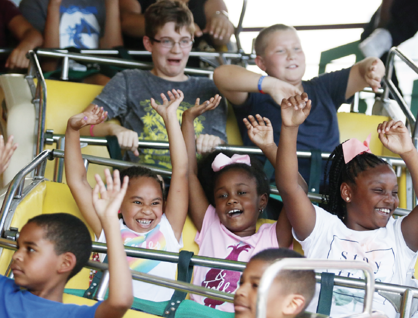 Fairgoers get excited on one of the roller coasters during the State Fair.