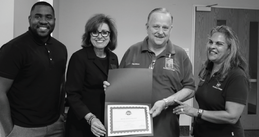 Shawndrea Smith, left, Richland President, Dr. Kay Eggleston, Jerry Owens and Sonia Ford receive Gold Green Business Certification.