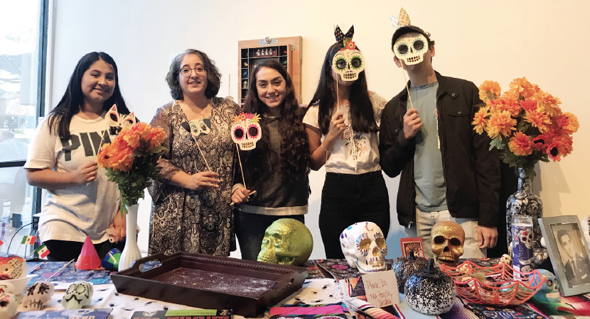 ALAS adviser Professor Michelle Navarro, second from the left, and members of the club share Latino culture during Dia de los Muertos on Nov. 2.