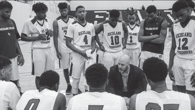 Coach Jon Havens gives a pep talk during the team's game against Brookhaven on Jan. 17.