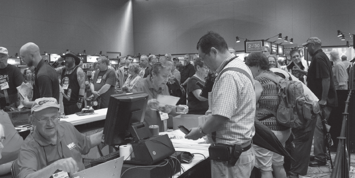 Attendees register for the National Rifle Association conference at Kay Bailey Hutchinson Convention Center.