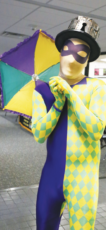A Mardi Gras harlequin entertains in the El Paso Student Lounge on Fat Tuesday Feb. 13.