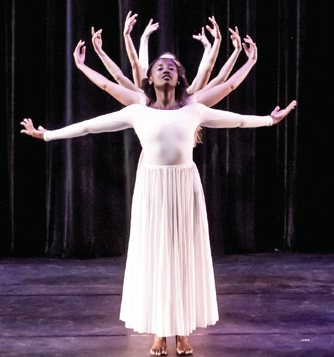 "Kyra McCarty and dancers perform in ""Utopia."" This semester's concert will be ""Take a Walk on the Wild Side."""