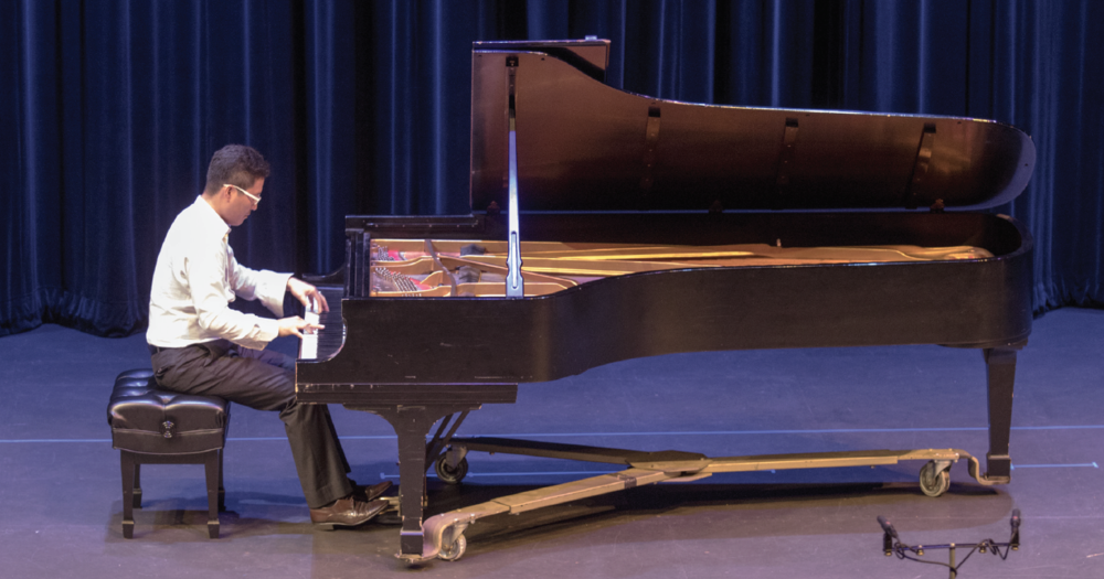 In-Seub Joeng plays piano in Fannin Performance Hall during a moving tribute on Sept. 11.
