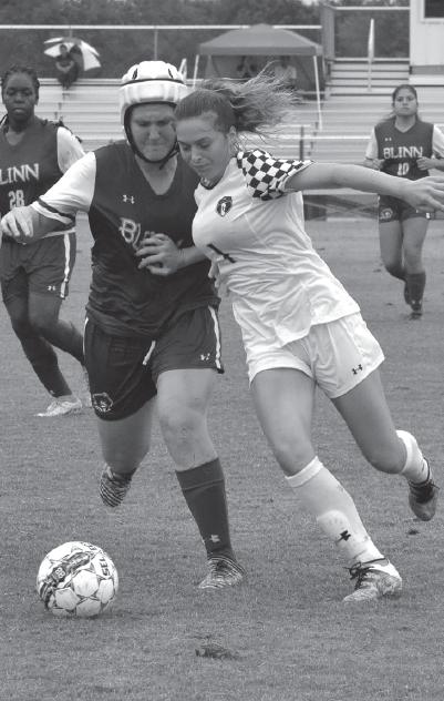Eva Mulligan shields the ball away from a Blinn college defender on Sept. 10.
