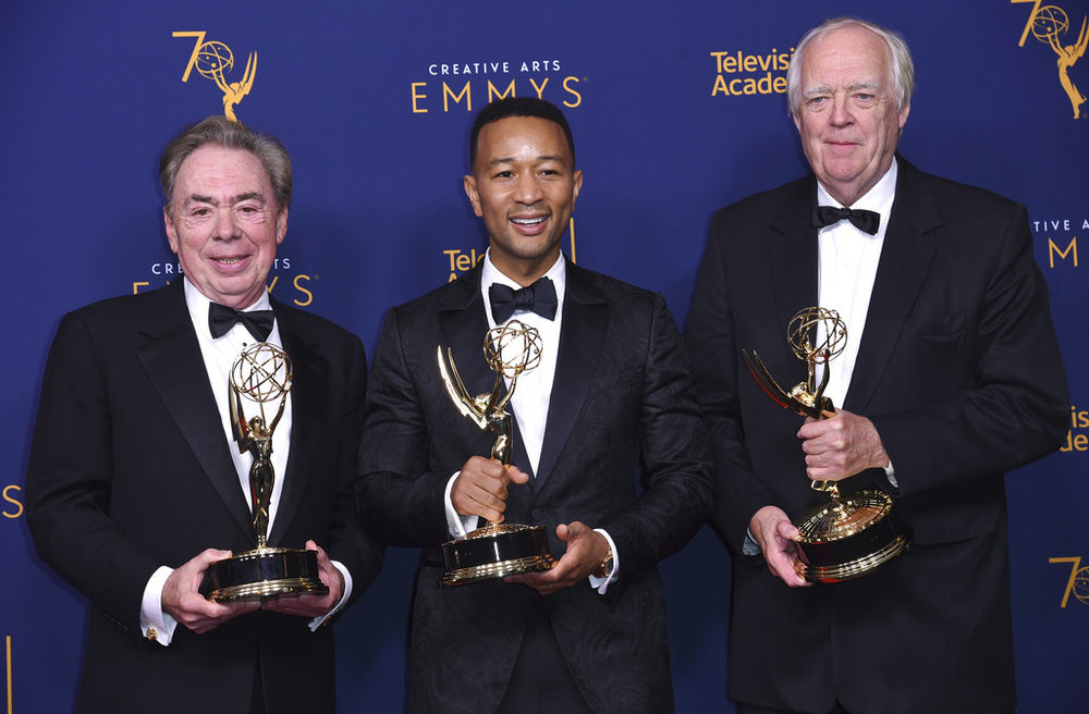 """Andrew Lloyd Webber, left, John Legend, and Tim Rice winners of the award for outstanding variety special for """"Jesus Christ Superstar Live in Concert"""" poses in the press room during night two of the Creative Arts Emmy Awards at The Microsoft Theater on Sunday, Sept. 9, 2018, in Los Angeles. (Photo by Richard Shotwell/Invision/AP)"""