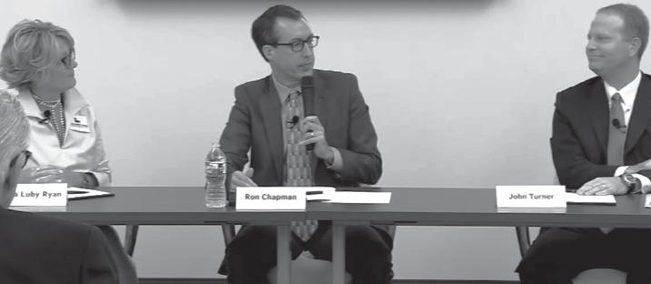 Lisa Luby Ryan (R), left, moderator Ron Chapman and John Turner (D) during Oct. 5 debate.