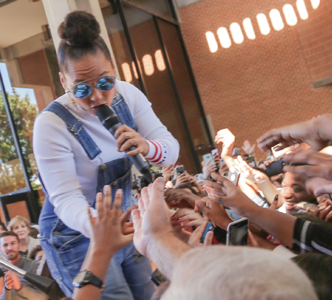 Musician and TV star Alicia Keys sings to the crowd during the get out the vote rally.
