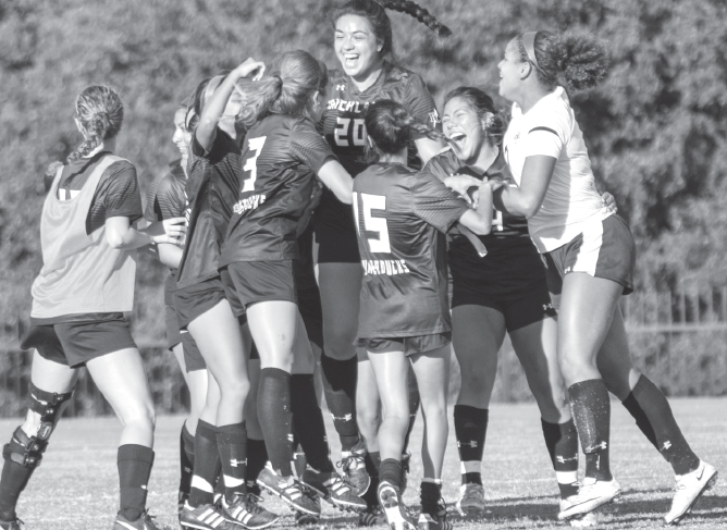 RIchland huddles up in celebration after Claudia Pedroza's game-winning goal on Oct.