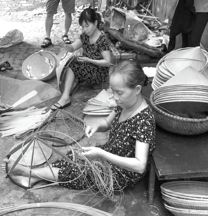 Women making the traditional conical hats by hand in a small village near Hanoi.