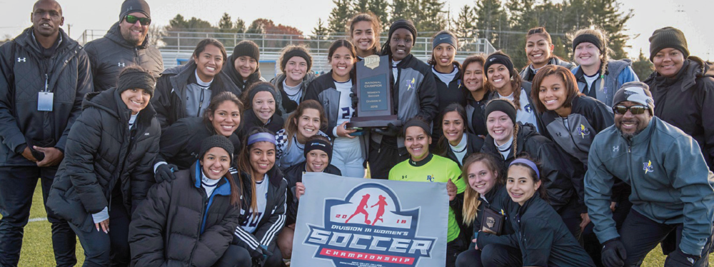 The Richland women's soccer team poses for a photo with the coaches after winning the Div. III national championship in a battle against Delta College in Loves Park, Ill.