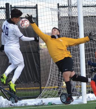 Richland's Lucio Martinez leaps to get past Nassau's goalkeeper.