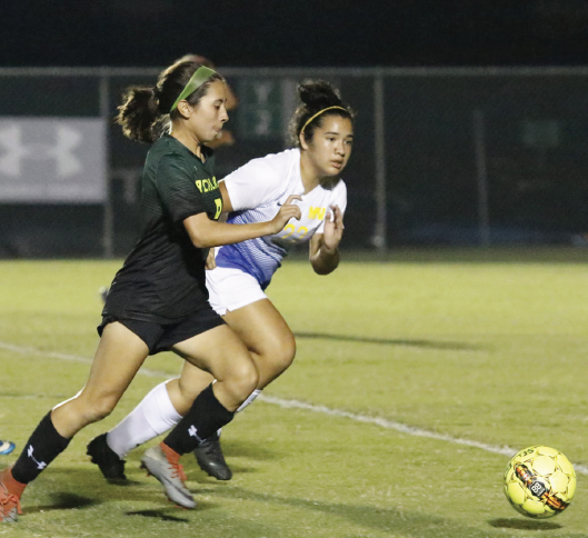 Ibarra, left, drives against Mountain View on Oct. 5. She won MVP honors at the Nationals.
