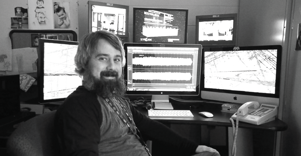 Jack Fletcher at his desk in the student journalism department in El Paso Hall.
