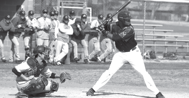 Kwamae Byers keeps his eye on the ball, waiting for the perfect pitch during the game against Cedar Valley on Feb 21.