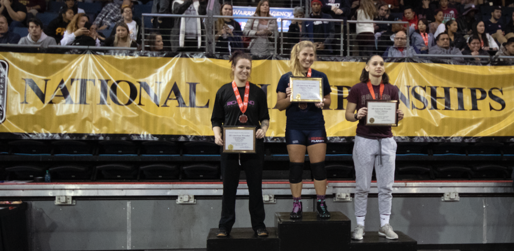 Christina Ellis, left, on the podium at the National Junior College Athletic Association (NJCAA) Wrestling Championship on March 16.