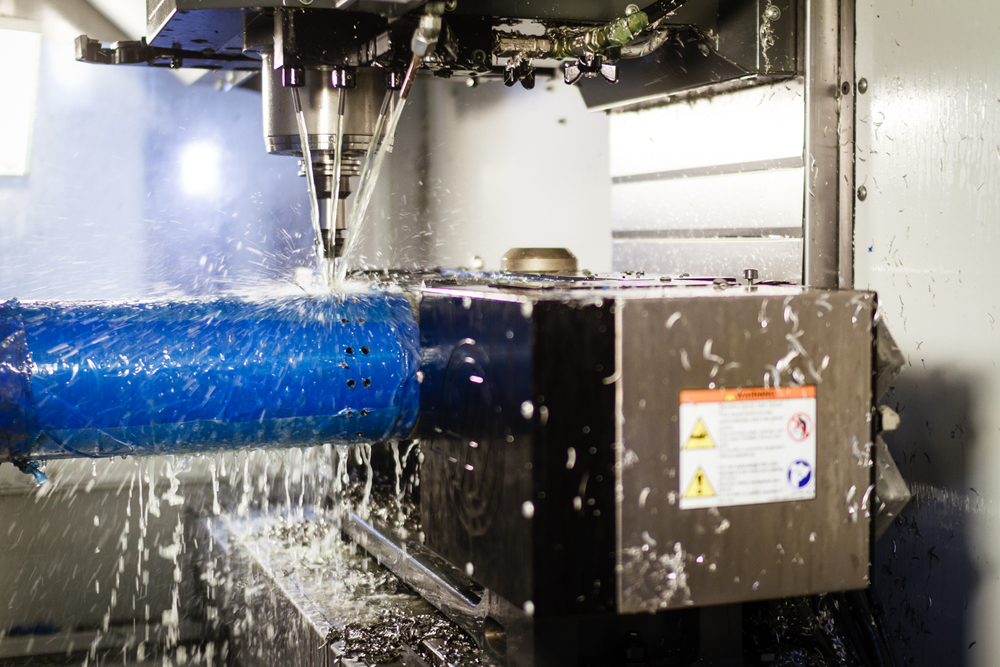 A 4-axis setup for machining the perforation pattern in the stainless steel bases