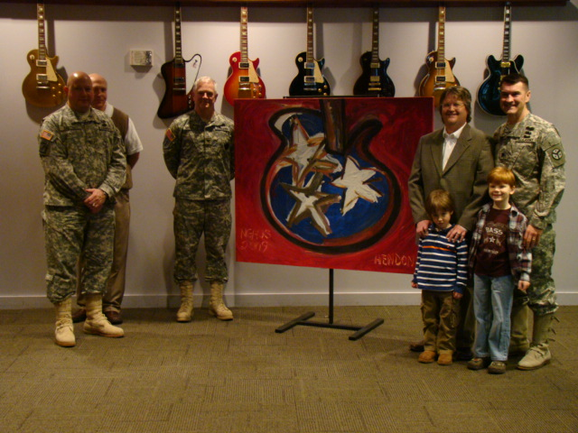 National Guard General receiving Rob's Tennessee guitar painting at the Country Music Hall of Fame
