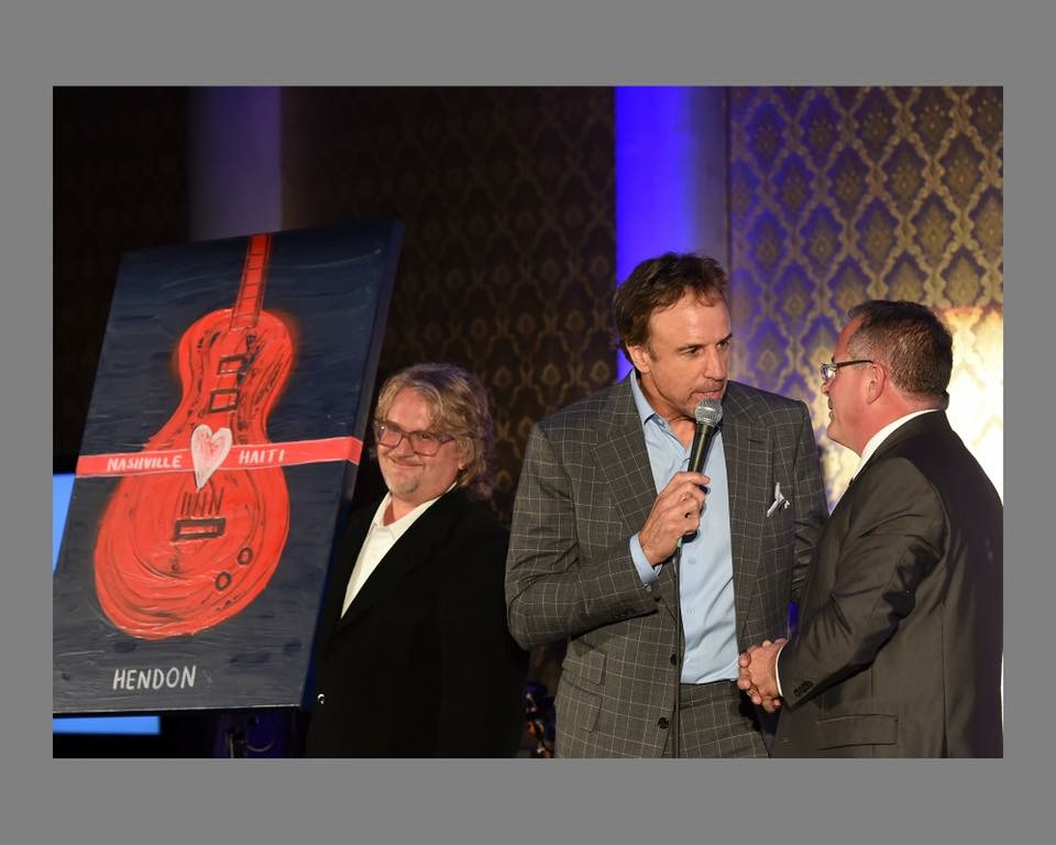 Kevin Nealon playing auctioneer to get the bids up on Rob's painting for Haiti